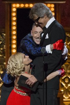 Hosts Alan Cumming and Kristin Chenoweth joke with actor Tommy Tune as he takes the stage to present the Best Direction of a Musical award. REUTERS/Lucas Jackson