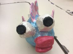 front view. We started from using some basic materials (Printer paper, news paper, tape, magazines, clay, tin foil, and other essential items) to make beautiful art sculptures.