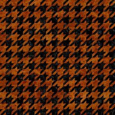 A houndstooth pattern using black marble and brown marble.