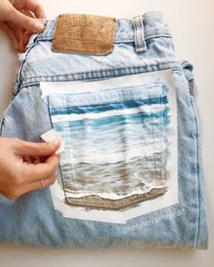 Tape peel of the Beach Bum jeans 😄🌊 - Ocean painted pocket by Kessler Ramirez Art. Painted jeans, painted pocket, painted denim, denim a - Diy Jeans, Painted Bags, Painted Clothes, Beach Bum, The Beach, Denim Kunst, Diy Fashion, Ideias Fashion, Diy Clothes Videos