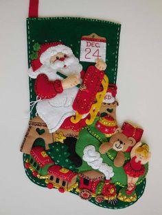 Finition bas de Noël  magasin de jouets du père Noël