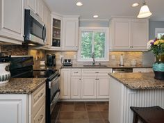 Cambria Canterbury countertops and Antique White cabinets  -----maybe with wood floors...........