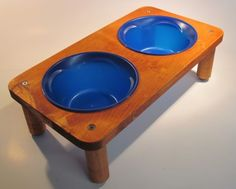 "Solid wood construction Removable 6"" Plastic food bowls (Blue) non marking feet 15"" Long X 8"" wide X 4 1/2"" high"