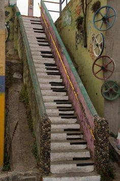 Piano key stairs with bike wheel wall art