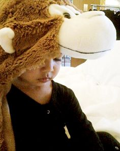 Monkeying around! Before throwing on her next eye-catching Paris Fashion Week outfit, Kim Kardashian spent some time with her daughter North West at their hotel. The Keeping Up With the Kardashians star posted an adorable photo of her little one wearing a hooded monkey blanket on Wednesday, Mar. 11.
