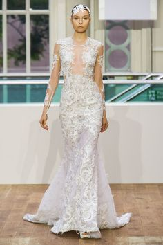 This dramatic Julien Macdonald gown has a swan-like beauty that reminds us of a delicate ballet costume. Sold!