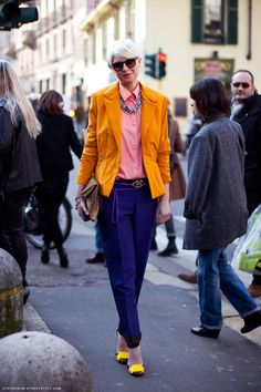 Elisa Nalin (fashion stylist) - statement accessories (belt) in coordinating colors pull together this colorful ensemble