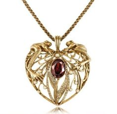 I WANT THIS!!!!  (In white gold, of course.)  (And an emerald instead of a ruby...)