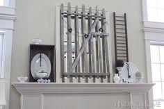 I like some of the design elements on this mantel, keys and whites, really eye catching