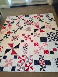 """My 2016 Quilt of Valor. I call this """"Pinwheel Star Party."""" I used the pattern I found on The Twiddletails Blog from Anina. I changed it up some as the pattern was 3 blocks across by 4 rows down. I did 5 blocks by 6 rows and I did the quilt as you go method with sashing."""