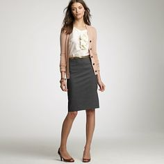 Wear a knee length skirt, white blouse and cardigan to your next interview!
