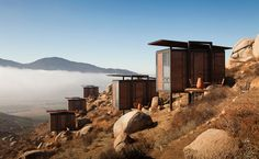 hotel endémico. cabins in the sky: rustic retreat in baja's wine country, gracia studio perches a series of cubes on a hill, offering panoramic views of the fertile valley below.
