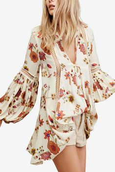 Fashion for all seasons: wear Free People's tunic-style dress with your favorite booties and style it with leggings on cooler days. Pullover styling Hits at thigh V-neckline; shift silhouette Sheer crochet details at front and sleeves.   Free People Tunic by Free People. Clothing - Tops - Long Sleeve Clothing - Tops - Tunics Colorado