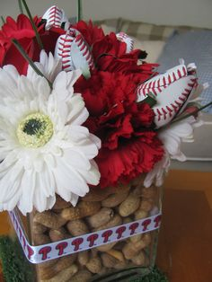 Baseball centerpiece - Phillies ribbon, peanut vase filler, real touch gerberas and roses, baseball rose buds, carnations.