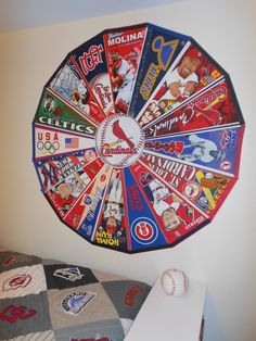 For my son's baseball-themed room, this is how we arranged his vast pennant collection using mounting tabs, a lot of them. Baseball Crafts, Baseball Boys, Baseball Teams, Baseball Stuff, Baseball Season, Softball, Baseball Pennants, Baseball Display, Dorm Room Designs