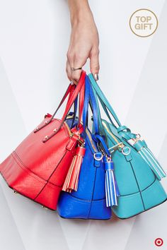 Simplify your Christmas shopping by snapping up this adorable mini bag for all the trendsetters on your gift list. This trendy handbag is easily something they can rock all year long, plus it comes in an array of fresh, bold hues—5 to be exact: red, rose gold, teal, blue and silver. Accented with a fun, oversized tassel, this is a must-have for the holidays.