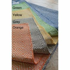 Make your outdoor space more vibrant with this handmade flatweave rug. Available in five different colors, this contemporary rug is made of durable synthetic fiber, so it will last for many years. Its eye-catching abstract pattern makes it stand out.
