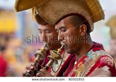 KATHMANDU - MARCH 25: Unidentified Buddhist lamas play music during Tsam mystery on March 25, 2010 in Kathmandu, Nepal. Through the language of dancing and pantomime Tsam tells about patrons of Buddhism by Zzvet, via ShutterStock