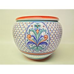Italian Deruta ceramics: a grand Fleur de Lis Cachepot. Consisting of two pieces, one terracotta flower pot with a hole for drainage, and one hand-glazed cachepot for the flower pot to rest inside. This piece is big indeed, but we have cachepots and planters of all sizes on our site of Italian pottery: http://www.bonechiimports.com