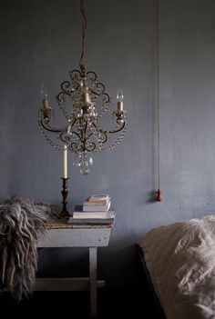mikkel-vang-photography..I like the feminine chandalier against the stark grey wall.