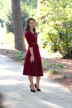 Athena is a 3/4 sleeve solid midi dress with a slight flare available in burgundy.