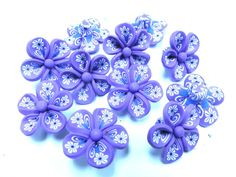 10 Fimo Polymer Clay Purple Flower Fimo Beads 25mm. $4.99, via Etsy.