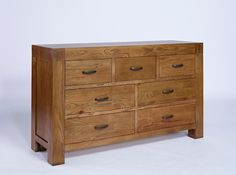 santana rustic oak 7 drawer wide chest is crafted from solid oak and carefully selected aston solid oak wall mirror