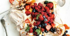 This giant pavlova with seasonal berries and salted caramel is designed to be put in the centre of the table. Give everyone a spoon and let them dig in!