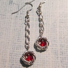 Long dangling red and silver earrings