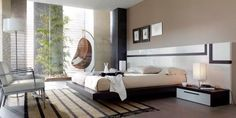 Dormitorio en blanco con detalles en madera oscura