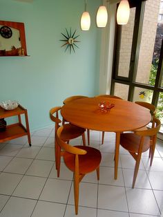 teak dining area, turquoise wall