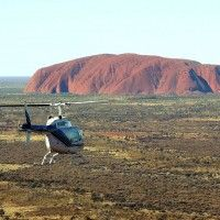 View Uluru in a new light with a spectacular helicopter flight with voyages. Stay at Ayers Rock Resort.
