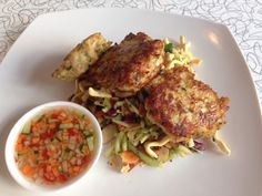 Massaman thai fish cakes with sweet and sour cucumber dipping sauce and crunchy Asian slaw