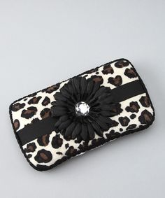 Function without fashion is a thing of the past. Slip store-bought wipes out of their lusterless case and into this fabulously frilly one. Covered in a vivacious animal print with a rhinestone-adorned flower, this chic accessory will attract a following of envious moms. 9'' W x 5'' HPlastic / micro velourSpot clean<...