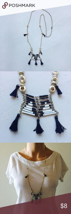 """Beaded tribal necklace Long necklace. Black and white beads and tassels for a tribal look. The chain has a warm silver hue, not quite gold. Measures 31"""" from end to end when unclasped. Jewelry Necklaces"""