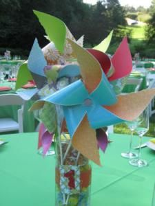 How about pinwheels of kid tables under tent or in park? Colorful and fun to play with!