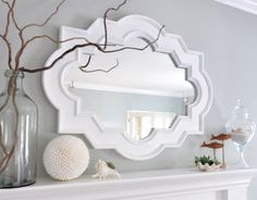 beach style mantel finding good coastal style without it looking silly and fake. Classy coastal.  Airy colors, with real beach accents.