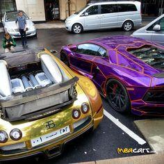 Custom aventador next to a gold Bugatti