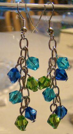 Dangling earrings with blue and green faceted beads
