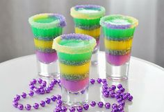 King Cake Jelly Shots • LouisianaLife.com....Recipe is available on our facebook page! http://on.fb.me/1mM93jp