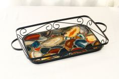 "Multi colored sliced Agate Geodes on a vintage metal tray. 12"" x 18"""