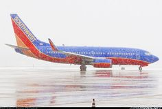 Southwest Airlines Boeing 737-7H4 N706SW encountering some light snow at Tulsa-International, January 2008. (Photo: Danny Fritsche)