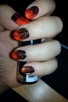 tried flaming nails.. I think combining red, orange with black colour worked together well.