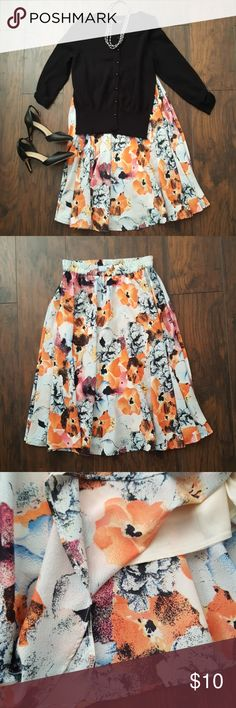 Midi skirt size M Midi floral skirt size M in very good condition elastic stretchy  waist. Built in Slip, flare skirt for dancing.  Light weight Cute skirt! Length of skirt is over the knee 28 inches, waist band laying flat 14 inches but waist band stretches about a few inches. mix nouveau Skirts Midi