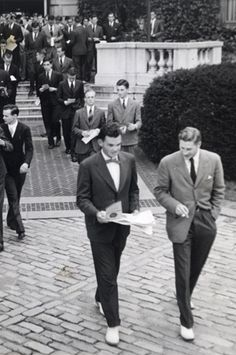 Yale Campus  Despite the changing demographics, nearly all male collegians wore the same basic items: Oxford cloth button-down shirts, chino trousers, Shetland crewneck sweaters, and penny loafers. Rounding out the wardrobe were a tan cotton gabardine raincoat and a wool duffel coat; a tweed sports jacket and a navy, single-breasted blazer; and two suits, one in gray flannel and one in seersucker. All were accessorized with a half-dozen ties.