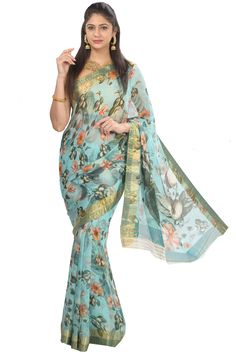 1e7a610ab446ea Exclusive blue shade pure chiffon saree is enhanced with digital print in  floral design all over. Intricate woven in gold floral border which add ...