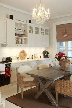 Kitchen with picnic style dining table and wicker chairs
