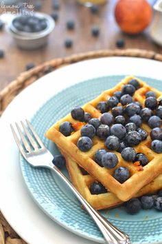 Blueberry Orange Waffles - flavored with orange juice and fresh orange zest and topped with warm vanilla maple syrup. Leslie Knope, Back To School Breakfast, Quick And Easy Breakfast, How To Cook Pancakes, Egg Dish, Waffle Iron, Breakfast Recipes, Breakfast Ideas, Baking Recipes