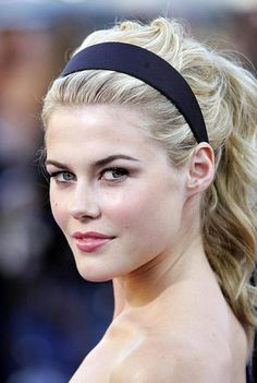 Rachel Taylor with high ponytail and waves