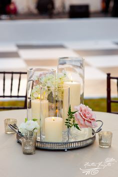 Very simple... Wedding Table Centerpiece. use mason jars instead of the regular vases, though:)